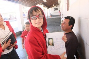 Alex showing off his homework after spending the day with his cousin in a 5th grade class in Mexico.